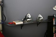 "Snowboard Shelf.                              Whoa.....lots of uses for old ""friends""!"