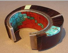 Sculptural bracelet by Charles Loloma, master Hopi jeweller.  Wood and metal inlaid with fossilized ivory, silver wedge, natural turquoise and coral; interior is inlaid with natural coral and recycled turquoise beads from older pieces.
