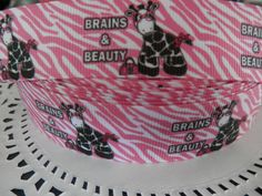 Check out this item in my Etsy shop https://www.etsy.com/listing/129941943/1-brains-and-beauty-zebra-grosgrain