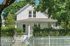 The home is the quintessential Sag Harbor cottage. Harbor House, Sag Harbor, Waterfront Homes, The Hamptons, Terrace, Home And Family, Shed, Outdoor Structures, Building
