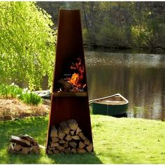 Wittus Phoenix Grill | Corten steel body with stainless steel grill rack. Functions as a grill or firepit, funneling smoke up through the top like a chimney. More beautiful in person — looks like a modern sculpture. (The price on the homeportfolio page is misleading... runs considerably less.)
