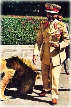 Emperor Haile Selassie looking dapper with one of his pet lions