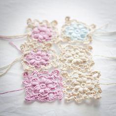 Step by step instructions to make a lacy crochet flower motif to use as a decorative edging or a scarf perhaps.