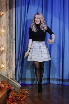 adorable holiday outfit. booties, black tights, black turtle neck, flirty skirt