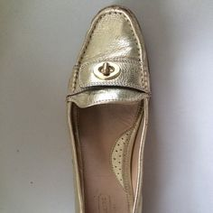 Coach Darcie gold leather loafers w/turn-lock MINT Retro impossible to find.  Gently worn. Bits of gold worn off showing red beneath - it's improved the look.- perfectly worn in Looks like gold leaf.ing They are a light gold, C logo soles looks great (I can show pics).  They are so effortlessly chic- the Signature turn-lock u never see anymore makes them a classic.  Comfy as hell- wear them over the holidays ! Coach Shoes Flats & Loafers