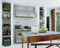 Darryl Carter's country kitchen in Virginia with Five-Star stove and Vent-A-Hood hood. The island is an 18th-century Italian table. Photo by Simon Upton for Elle Decor.