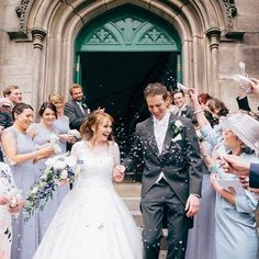 Sarah and Dan making their way through a veritable barrage of confetti. Love this shot!