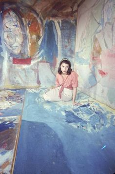 Helen Frankenthaler sitting amidst her art in her studio. NY, 1956