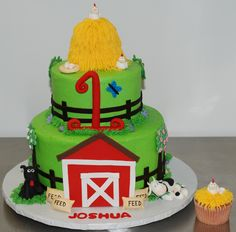 """Farm Birthday Cake - Here's another version of the farm cake.  This cake is a 9"""" strawberry cake combined with a 6"""" chocolate cake and the smash cupcake is strawberry cake. Everything is frosted in vanilla buttercream.  The customer requested the chickens and eggs and the black dog. The rest of the design was left up to me.  The hay stack on top is a Rice Krispy treat covered in buttercream.  I hope they enjoy their cake!"""