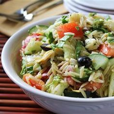 Greek Orzo Salad  Ingredients: 1 1/2 cups uncooked orzo pasta   2 (6 ounce) cans marinated artichoke hearts 1 tomato, seeded and chopped   1 cucumber, seeded and chopped   1 red onion, chopped   1 cup crumbled feta cheese  1 (2 ounce) can black olives,  drained 1/4 cup chopped fresh parsley  1 tablespoon lemon juice   1/2 teaspoon dried oregano  1/2 teaspoon lemon pepper 1. Bring pasta to a boil for 8 to 10 minutes.  2. Combine drained pasta with all ingredients and chill 1 hour…