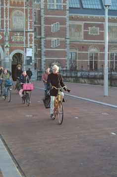 Hand signals for cyclists and pedestrians, morning rush hour, Rijksmuseum, central Amsterdam
