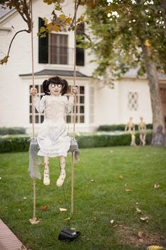 Make swing for tree in front yard with baby doll swinging in it