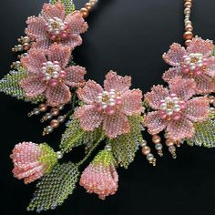 Image may contain: 1 person Beaded Jewelry Designs, Seed Bead Jewelry, Bead Jewellery, Seed Bead Flowers, French Beaded Flowers, Bead Embroidery Jewelry, Beaded Embroidery, Beads And Wire, Bead Crafts