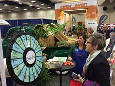 Kate Tscharner of CFBF qualifies another convention attendee for a prize from the California booth at the IDEAg Trade Show. Buy this Prize Wheel at http://PrizeWheel.com/products/floor-prize-wheels/floor-table-black-clicker-prize-wheel-18-slot/.