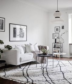 &Tradition Formakami pendant makes a beautiful addition to this all white dreamy living room!