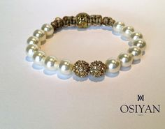 https://www.cityblis.com/7451/item/12563  Swarovski Element nacreous beads and crystal pave bead bracelet - $95 by Osiyan Paris  This bracelet is made with Swarovski Elements nacreous pearl and two crystal pave beads. Light Brown nylon cord is used to ensure the highest degree of quality and durability.The size of the bracelet is adjustable. Handmade in France   Ce bracelet est fabriqué avec des perles Swarovski Elements...