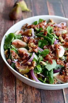 Fig, Blue Cheese, and Walnut Salad with Warm Bacon Dressing.  This salad has it all, and is really easy to put together.  Would be great with pears, too!   hostthtoast.com