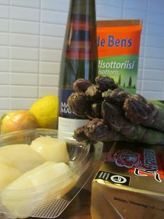 Cooking at home. Making Asparagus Risotto with Scallops.
