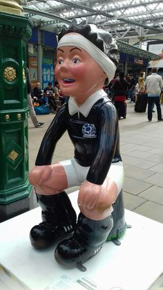 Statue of a famous rugby player or football player