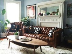 Couple friendly decor, leather couch, organic modern, wood coffee table, west elm, home decor