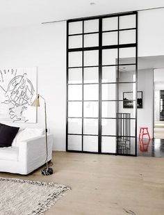 There's nothing as sleek as a glass partition. They're often used in office spaces, but totally appropriate for the home, too! Check out these glass partitions perfect for dividing a room in your home. For more interior ideas, go to Domino. Interior Barn Doors, Interior Exterior, Interior Architecture, Modern Interior, Interior Windows, Classical Architecture, Steel Windows, Windows And Doors, Front Doors