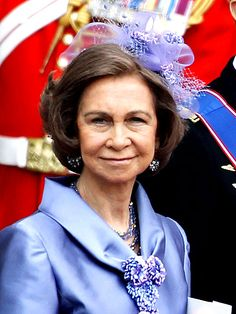 QUEEN SOFIA    The Spanish monarch is a vision in violet, from her silk suit to her netting fascinator.