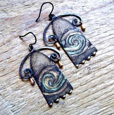 Earrings made of recycled tin, art nouveau, blackened wire, small brass drops Please keep in mind that this is made from a recycled tin container. Scratches, marks, and age are part of the charm of recycled materials.