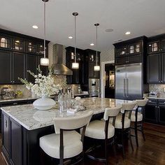 Not sure who designed this kitchen but it is gorgeous!
