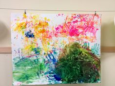A toddler classroom used varying sensory objects to paint a large birthday card for one of their classmates. In this, they explored different textures and observed how different materials produced different effects with the paint.