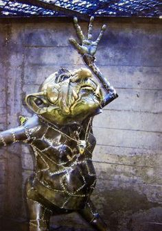 "Troll, created by sculptor Connie Ernatt, that ""lives"" under a grate near the Keeper of the Plains statue, Wichita, Kansas"