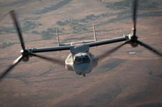 "A Bell/Boeing MV-22B Osprey, from Marine Medium Tilt Rotor Squadron 165 (VMM-165) ""White Knights,"" moves in for fuel from a Lockheed Martin KC-130J Super Hercules.  ottosenphotography.com   © Matt Ottosen"