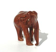 Vintage Carved Wooden & Bone Elephant by Donellensvintage on Etsy, $19.97