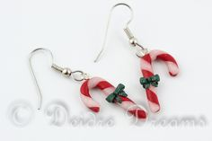 """Candy Cane Earrings, Christmas Earrings, Polymer Clay Earrings, Peppermint Candy Canes, Christmas Jewelry, Holiday Jewelry These cute little earrings are called """"Candy Canes"""" These cute little earrings are hand sculpted from polymer clay and are made to order, and will be made within 2 - 3 working days after ordering."""