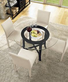Halo Ebony Round Dining Table with Glass Top - Crate and Barrel Round Glass Kitchen Table, High Dining Table, Glass Dining Table, Dining Table In Kitchen, Table Baril, Stone Rug, Modern Glass, Dining Room Furniture, Furniture Ideas