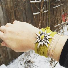 """""""Hands down the most comfortable bracelet I've ever owned. I love the bold metal edelweiss mixed with the soft look of the fabric. I've worn it everyday since I got it! Fabric Bracelets, Cuff Bracelets, German Festival, Usa Baby, South Tyrol, Knit Wrap, Swiss Alps, Feeling Great, Bracelet Making"""