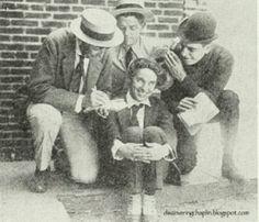 """Charlie, Elmer Ellsworth Albert Austin and Chuck Reisner in clothes for """"The Kid""""."""