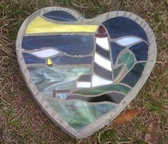 Real Stained Glass Stepping Stone: Inspired by the smell of Spring in the air, real stained glass, cut and placed in this 2 inch thick heart-shaped cement stepping stone was made by me.