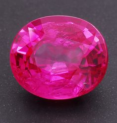 Purplish pink included  Mahenge Spinel oval weighing 1.76cts, from Tanzania.