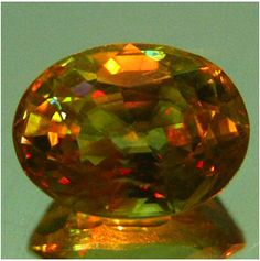 Natural yellow Sphene with rainbow spark (faceted) / Madagascar