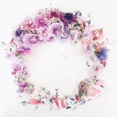 pale pink wreath made out of summer flowers like sweet peas and cornflowers
