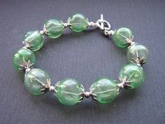 Bubble Glass Bracelet - Green £10.00 ...That is so cute. I LOVE the color. :)