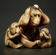 """Netsuke, ivory. Japan, late 19th cent.One big and two smaller monkeys, depicting the popular """"Three Truths"""" theme, namely see, hear, speak no evil – accordingly the monkeys Kikasaru, Misaru und Iwasaru. All three animals wear jackets, their fur is compactly carved and exactly executed. Also their faces and movements are very life-like. A fine point: the big monkey has a spider net on his clothes and a beetle sitting on his head. Style and quality of this work could indicate Masatami, famous…"""