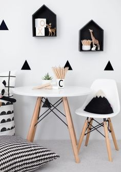 Monochrome style with just a hint of beige because it's all the rage RN! Check out more ideas for your living room here: http://www.pasteltrail.com #livingroom #homedecoration #homedecorideas