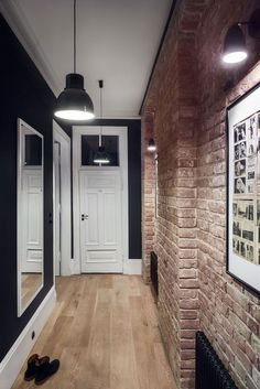 Masculine entryway with exposed brick walls and dark hues. Loft Interior, Brick Interior, Home Interior Design, Interior Decorating, Flur Design, Hall Design, Design Design, Exposed Brick Walls, Hallway Designs