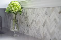 Herringbone backsplash tile in Calacatta marble by Well-Nested Interiors