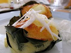 Bibingka , a Philippine rice cake, baked with slices of native white cheese and salted duck eggs  is an all-time Filipino favorite merien...