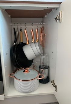 And up next, check out these small kitchen storage and organization ideas as well as these small bathroom design and storage inspirations. Small Kitchen Space Savers, Kitchen Organization For Small Spaces, Small Kitchen Storage, Kitchen Storage Solutions, Camden Kitchen, Cozy Kitchen, Kitchen Items, Pan Storage, Storage Ideas