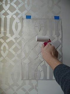Tutorial: stenciling pearlescent white metallic glaze over white paint two base coats of Benjamin Moore Linen White in Matte Regal and for the stencil a ready-made quart of B.Moore Studio Finishes Latex Metallic Glaze in Pearlescent White.