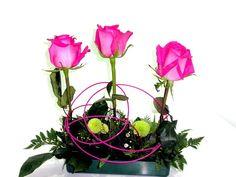 Centro para mesa con rosas.