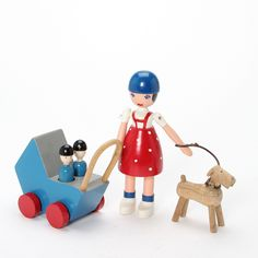 """1338/2004 - Kay Bojesen: """"Lise with baby carriage and the dog Tim."""" Figure and carriage with two loose figures of painted wood. (5)"""